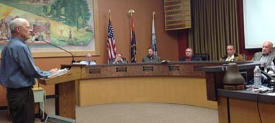 Cindy Barks/The Daily Courier<br>In front of a packed council chambers Tuesday, Dan Campbell of the Granite Dells Preservation Foundation appeals to the Prescott City Council about the value of preserving 83 acres of land.