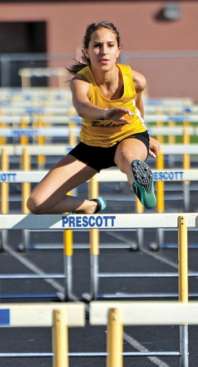 Matt Hinshaw/The Daily Courier<br>Prescott's Erin McGuiness competes in the girls 100 meter hurdles Tuesday afternoon during the PHS track meet.
