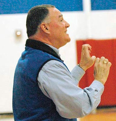 Cheryl Hartz/Chino Valley Review, Courtesy<br>Chuck Schmitt coaches the Chino Valley boys' basketball team this past December during the Mayer Holiday Tournament.