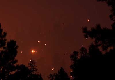 Padraig Houlahan/Courtesy photo<br> Hillside hotspots light up the forest near Flagstaff on Friday evening.