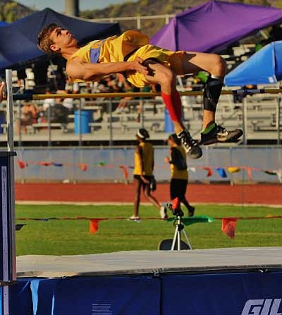 Wade Ward/Courtesy photo<br> Perry Reed Jumps 6-foot-2 and finishes second overall Saturday at the Westside Invitational, Deer Valley High School, in Glendale.