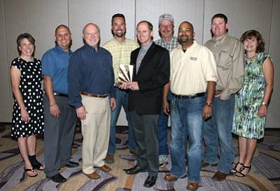 Courtesy photo<br> From left, Jennifer Toth (ADOT), Paul Baca (URS), Steve Pageau (URS), Abe Geupel (Fann Contracting), Alvin Stump (ADOT), Marty Schulte (ADOT), Bobby Lall (ADOT/Horrocks Engineers), T.C. Fish (ADOT), and Amanda McGennis (AGC) pose for the award Fann Contracting Inc. and ADOT received for the Sunset Point Rest Area Rehabilitation project.
