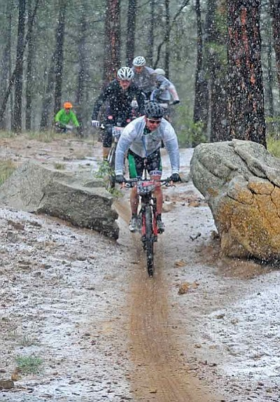 Matt Hinshaw/The Daily Courier<br>Racers make their way through the 50-mile course as snow begins to accumulate on the ground during the Whiskey Off-Road 50 Proof in Prescott on Saturday.