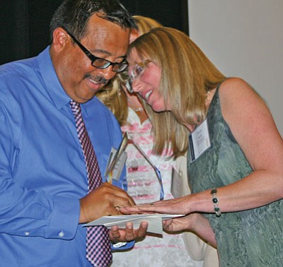 Salina Sialega/Special to the Courier<br> 2013 Teacher of the Year Bonny Smith of Sedona, right, congratulates this year's winner, Sonny Martin of Ash Fork, during the Yavapai County Education Foundation's annual banquet, Friday at the Prescott Resort.