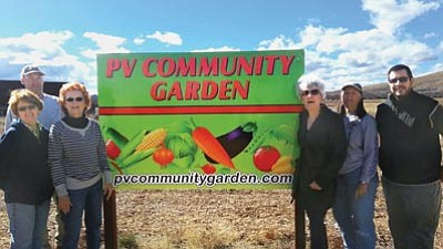 Courtesy photo<br>Posing with the Prescott Valley Community Garden sign are executive board members Christy Allen, Jack Allen, Jann Kemp, Gina Webber, Robin Fox and Dave Sawyer.