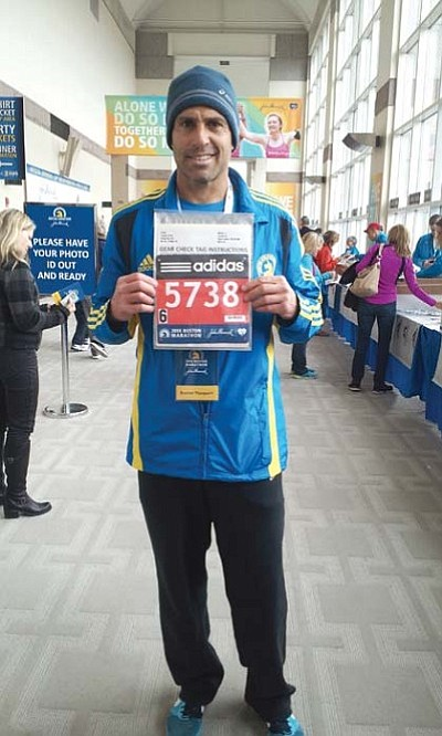 Courtesy<br>Rob Turpin smiles after receiving his bib number in Boston last month.