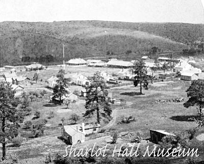 Sharlot Hall Museum/Courtesy photo<br>In this early-1880s photo of Fort Whipple, the fort fence is visible behind two private residences in the foreground.