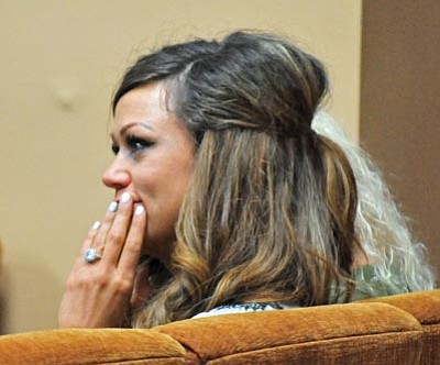 Matt Hinshaw/The Daily Courier<br> Juliann Ashcraft, widow of Granite Mountain Hotshot Andrew Ashcraft, listens to closing arguments during a Public Safety Retirement System hearing at Prescott City Hall Thursday.