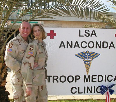 Courtesy photo<br> Veterans Donald and Jamie LaRue, on duty in Iraq.
