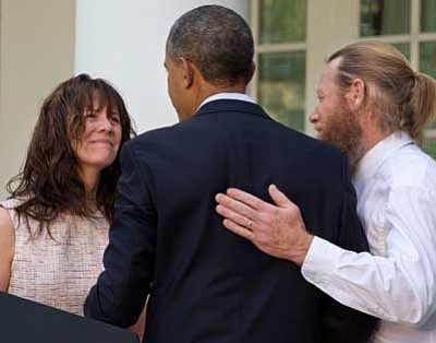 Jacquelyn Martin/The Associated Press<br> Parents of U.S. Army Sgt. Bowe Bergdahl, Jani Bergdahl, left, and Bob Bergdahl, turn to President Barack Obama after he spoke in the Rose Garden of the White House in Washington, after the announcement that Bowe Bergdahl has been released from captivity in Afghanistan.