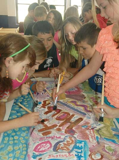 Patrick Whitehurst/The Daily Courier<br> Students at the Prescott Valley Boys and Girls club work together on an art project Thursday. The artistic creation is part of the arts and crafts program put on during the club's summer programming.