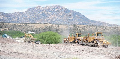 Les Stukenberg/The Daily Courier<br> Heavy equipment from Fann Contracting works the ground at the future site of the Lakeview Plaza shopping center near the intersection of Willow Creek and Willow Lake roads in Prescott Monday morning.