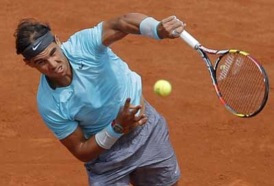 Michel Spingler/The Associated Press<br> Topspin or underspin? Spain's Rafael Nadal hits the ball during the fourth round match of the French Open tennis tournament on Monday.