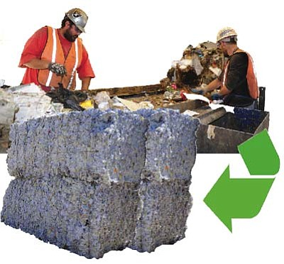 Les Stukenberg/The Daily Courier<br> Workers separate recyclables on a conveyor belt at Patriot Disposal in Prescott Valley.