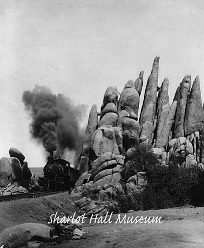 """Sharlot Hall Museum/Courtesy photo<br>A """"Peavine"""" railroad train passes Point of Rocks in Granite Dells."""