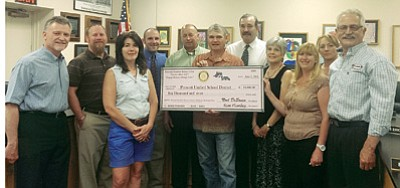 Courtesy photo<br> Pictured from left to right are Rotarian Rex Townsend, PUSD Assistant Superintendent Joe Howard, Rotarian Lindsay Sherrard, PUSD Board member Brent Roberts, PUSD Superintendent Dave Smucker, Rotary President Noel DeSousa, Board member John Mackin, PUSD Board member Maureen Erickson, Co-Director of the Summer Math and Reading Clinic Pam Percival, PUSD Board President Tina Seeley, and Rotarian Steve Sischka. Members of the Prescott Frontier Rotary Club presented the district with a $10,000 check during their regular meeting Tuesday for use in the summer math and reading program.