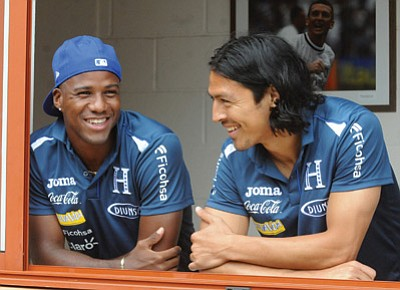 Fernando Antonio/The Associated Press<br>Honduras national soccer team players, Juan Carlos Garcia, left, and Roger Espinoza talk at their hotel in Porto Feliz, Brazil, on Tuesday. Espinoza played for the Yavapai College Roughriders in Prescott in 2005 and '06, and is making his second World Cup appearance with Honduras, which will play in Group E.