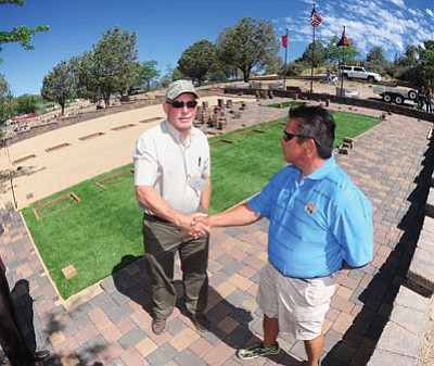 Les Stukenberg/The Daily Courier<br>Ted Ihrman, superintendent of the Arizona Pioneers Home and Cemetery, and JP Vicente, the Granite Mountain 19 family services coordinator, shake hands Wednesday on an agreement over the layout and design of the memorial site.