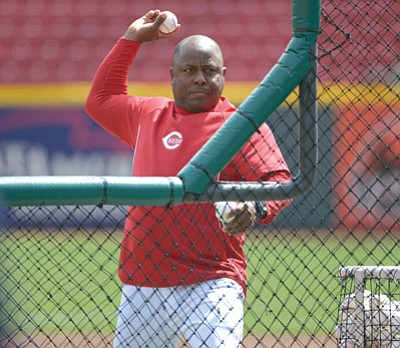 Michael Keating/The Associated Press<br>Cincinnati coach Billy Hatcher throws batting practice prior to the Reds and St. Louis Cardinals' opening day game on March 31, 2014, in Cincinnati. Hatcher, a former Roughrider, will be inducted into the Yavapai College Athletic Hall of Fame this October, along with the 1990 YC men's soccer team, which won the first of the program's seven national championships (below).