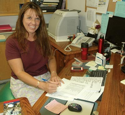 Patrick Whitehurst/The Daily Courier<br> Northpoint Expeditionary Learning Academy Director Geneva Saint-Amour works at her desk Friday, June 13. Saint-Amour will retire from the school at the end of the month.