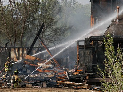 Scott Orr/The Daily Courier<br> Firefighters from the Chino Valley Fire Department battle a blaze on Linda Lane near East Road 1 South on sunday. No one was injured in the fire.