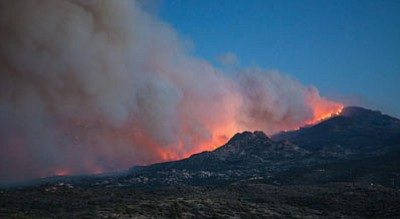 Janet Cameron/Courtesy photo<br>The Doce Fire surged past Granite Mountain June 18, 2013. Investigators still have not determined the fire's cause.