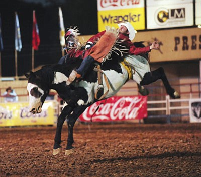 Les Stukenberg/The Daily Courier<br>Kaycee Feild gets a score of 83 on Double Valley in the bareback bronc riding event at the Prescott Frontier Days Rodeo back on June 29, 2012.