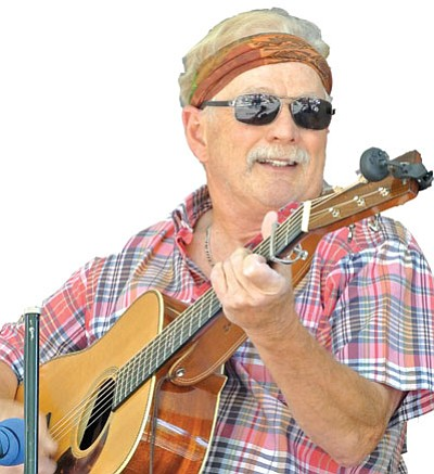 Matt Hinshaw/The Daily Courier<br> Lem Johnson, a member of The Thumb Brutes of Prescott, performs with his band Saturday afternoon during the 33rd  Annual Prescott Bluregrass Festival at the courthouse plaza in downtown Prescott. The festival continues today until 3 p.m.