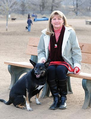 Les Stukenberg/The Daily Courier<br>Linda Nichols, winner of the $500,000 Beneful Dog Park contest, poses for a photo Dec. 18, 2013,  at the dog park on Willow Creek Road with her dog Callie.