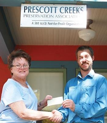 Courtesy Photo<br>Former Alta Vista Garden Club President, Dianne Moyer and Michael Byrd, Prescott Creeks Preservation Association.