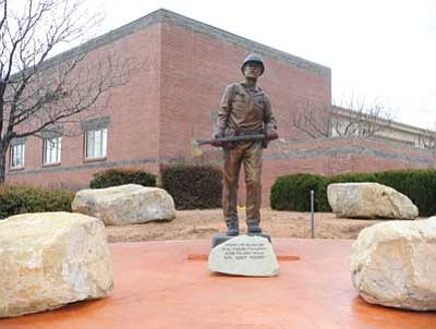 "Les Stukenberg/The Daily Courier<br> The statue ""Spirit of the Wildland Community"" has a new home in front of Station 71 on White Spar Road in Prescott."