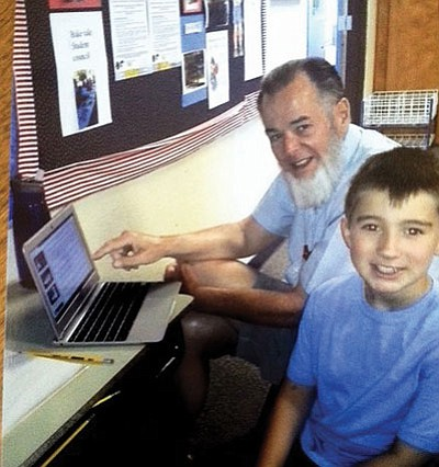 Courtesy photo<BR> Volunteer Norm Samuelson works with student Andrew Howell from Washington Elementary School.