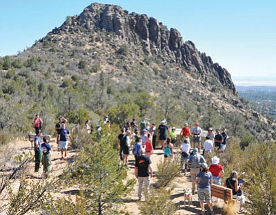 Les Stukenberg/The Daily Courier<br> Hikers listen to Todd Rhines and Duane Steinbrink talk about the crew and their history during the Granite Mountain Hotshots Thumb Butte Tribute hike Monday morning.