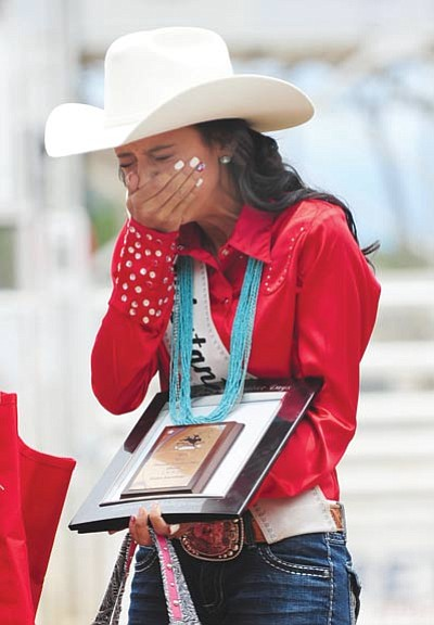Les Stukenberg/The Daily Courier<br> Sabrina Swearingin reacts after being named the Prescott Frontier Days Queen for 2015 in a ceremony Sunday morning at the Prescott Rodeo Arena.