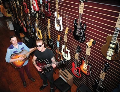 Les Stukenberg/The Daily Courier<br>Managers Dylan Ludwig and Addison Matthew at the Gray Dog Guitar in Prescott Wednesday morning.