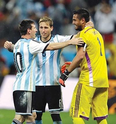 Victor R. Caivano/The Associated Press<br>Lionel Messi, left, Lucas Biglia and keeper Sergio Romero celebrate Argentina's big win Wednesday in Brazil.
