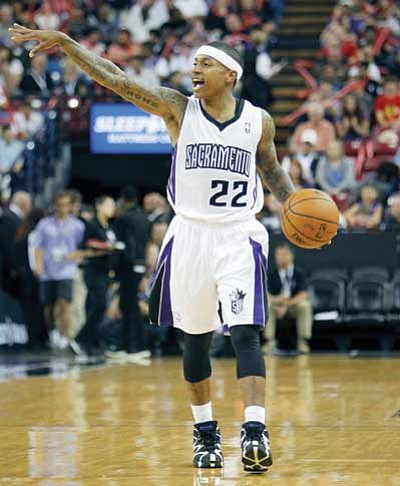 Steve Yeater/The Associated Press<br> Sacramento Kings Isaiah Thomas brings the ball up court against the Minnesota Timberwolves during a game April 13.