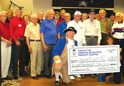 Courtesy photo<br> Steve Monez, President, of the SAR Prescott Chapter presents a check to Susan Howe, the Founder of Honor Flight and a Prescott resident.