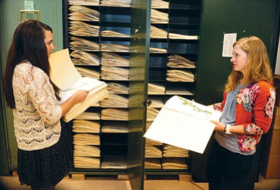 Les Stukenberg/The Daily Courier<br> Curatorial assistant Elisa Elizondo, left, and program coordinator and collections manager Lisa Zander hold some of the 8500 specimens donated to the Natural History Institute Herbarium from Yavapai College.