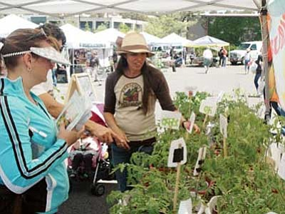 Daily Courier file photo<br> The Prescott Farmers Market is held each Saturday morning in the parking lot of Yavapai College's Prescott campus.