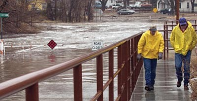 The Daily Courier, file<br> Prescott drainage maintenance workers inspect Lincoln Avenue where the confluence of Butte Creek and Miller Creek created flooding conditions during a past monsoon season.