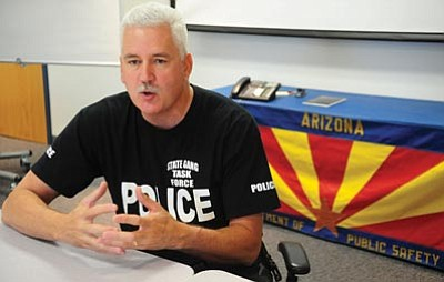 Les Stukenberg/The Daily Courier<br>Arizona Department of Public Safety and Yavapai County Gang & Immigration Intelligence Team Enforcement Mission (GIITEM) Sgt. Tim Bolger describes some of the background leading to the arrest of brothers Pedro and Fidel Sandoval-Flores brothers in a murder for hire plot.