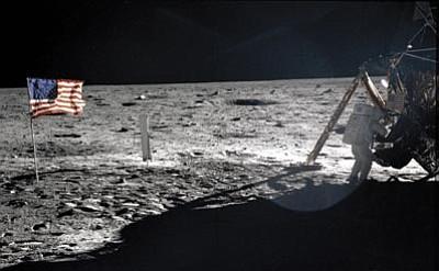 NASA/The Associated Press<br> Astronaut Neil Armstrong walks on the lunar surface July 20, 1969.