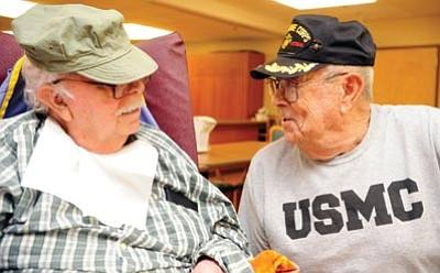 Les Stukenberg/The Daily Courier<br> Lee Paul, at right, shares a story with Lee Dortsch at the VA Community Living Center in Prescott Thursday morning.