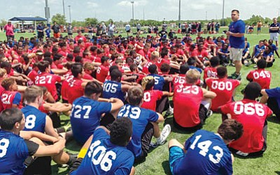 Donald Hooton Sr./The Associated Press<br>In this April 27, 2014 photo provided by Donald Hooton Sr., Donald Hooton Jr. addresses players at the USA Football regional football camp about the potential dangers of using performance-enhancing substances at the Houston Sports Park in Houston. Experimentation with human growth hormones by America's teens more than doubled in the last year, according to a large-scale national survey. Hooton works for the Taylor Hooton Foundation, named after his brother, Taylor, a 17-year-old high school athlete whose suicide in 2003 was blamed by his family on abuse of steroids.