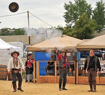 Matt Hinshaw/The Daily Courier<br>Members of the Prescott Regulators stage a performance at a past Whiskey Row Shootout.