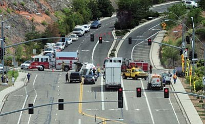 Les Stukenberg/The Daily Courier<br> A cement truck overturns at Prescott Lakes Parkway and Highway 69 in Prescott Aug. 2, 2012.