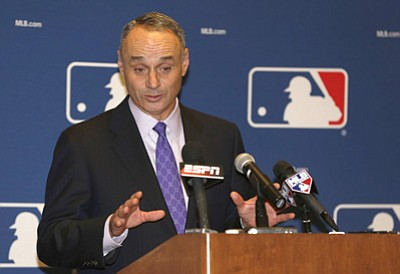 Reinhold Matay/The Associated Press<br>Rob Manfred, Chief Operating Officer of Major League Baseball, talks to the media following baseball's general managers' meetings Nov. 14, 2013, in Orlando, Florida.