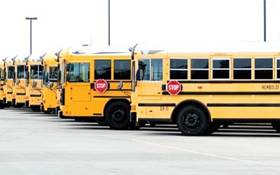 Les Stukenberg/The Daily Courier<br> School buses from the school districts in the quad-city area will be back on the roads Monday morning.