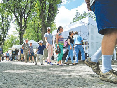 People check out the many vendors during the Mountain Artists Guild 64th annual Fine Arts and Crafts Festival on Saturday afternoon at the courthouse plaza in downtown Prescott. The event continues today.(Matt Hinshaw/<br /><br /><!-- 1upcrlf2 -->The Daily Courier)